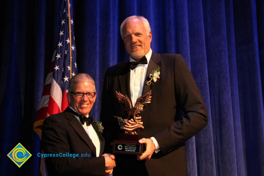 College president with former NBA player Mark Eaton