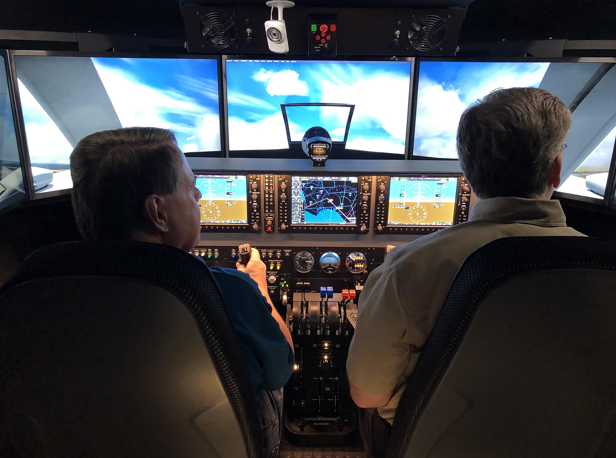 Aviation professors using flight simulator