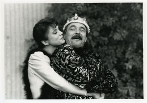 A woman hugging man on stage