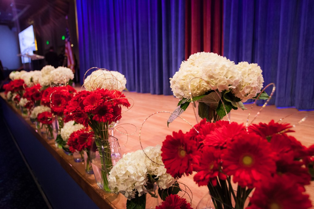 Flowers in vases on the edge of a stage