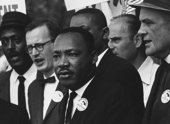 Martin Luther King speaking, along with various other men
