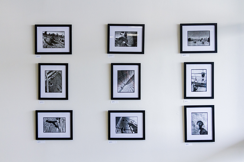 Framed photographs on a wall