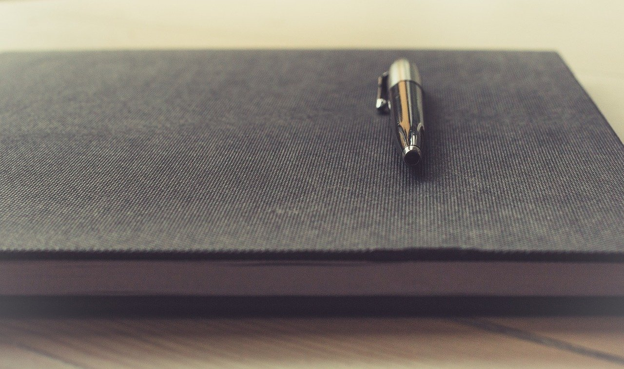 Pen on top of a closed journal