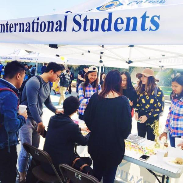 Students gathered at an International Students booth