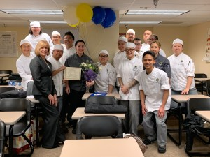 Culinary students gather around instructor Chef Amanda Gargano