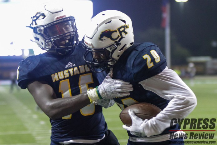 Grant Saracene (15) congratulates Donovan Johnson (20) on returning an interception almost 70 yards for a touchdown during Cy Ranch's regular season finale and District 14-6A championship against Tomball Memorial Thursday night (Nov. 8, 2018) at Cy-Fair FCU Stadium. The Mustangs took a 35-14 victory in the week 11 game. (Cypress News Review photo by Creighton Holub)