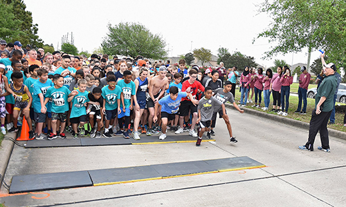 Dr. Mark Henry (far right), CFISD superintendent of schools, starts the 5K at the fifth annual Superintendent's Fun Run and Festival in March 2018, which generated a record $100,000 for the Cy-Fair Educational Foundation. The sixth annual event will be March 2 at the Berry Center and Towne Lake Community. (CFISD courtesy photo)
