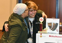 Cy-Fair High School senior Sara Mendez hugs her mother after winning first place in the Advanced Culinary division of the CFISD Cupcake Battle for her black forest cupcake. Mendez won Best Presentation the previous two years before earning first place at the competition, held Jan. 11 at the Berry Center. (CFISD courtesy photo)