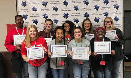 Nine CFISD student athletic trainers earned 2018-2019 Texas State Athletic Trainers' Association Academic All-State honors. Standing in the front row (from left) are Allison Vicklund (Langham Creek), Maya Simms (Cy-Fair), Madi Maxwell (Cy-Fair) and Rizqa Oresanya (Cypress Woods). Standing in the back row (from left) are Joshua Alexander (Langham Creek), Penny Bond-Reading (Cy-Fair), Alyssa King (Cypress Springs), Catherine VanHoose (Cypress Woods) and Trinity DePaulis (Cypress Woods). (CFISD courtesy photo)