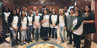 Houston City Councilmen Jerry Davis (center back row) and Dave Martin (back row in gray suit) pose with Cypress Falls High School Debate I students and their teacher Miranda Fairman (right) during a trip to City Hall on Jan. 24. The class recently visited Houston City Hall and attended a City Council meeting to observe government and policymaking in real life. Boykins served as the class' guide. (Hunter King, Cypress Falls HS)