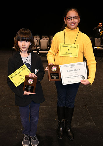 Winner William Choi-Kim, left, from Black Elementary School and runner-up Shomili Ghosh from Gleason Elementary School celebrate advancing to the Houston Public Media Spelling Bee after the CFISD Elementary Spelling Bee on Jan. 29 at the Berry Center. (CFISD Courtesy photo)