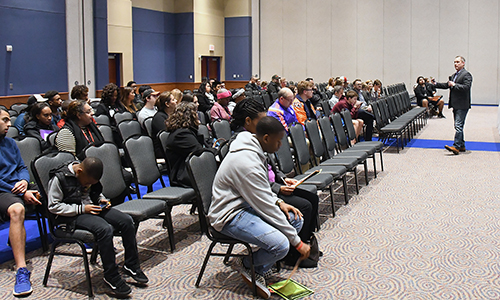 Ray Zepeda (right), CFISD director of athletics, leads a session during the College Special Interest Night, held Jan. 30 at the Berry Center by CFISD's office of advanced academics. The event included a college fair followed by conference-style presentations on various topics, including highly selective schools, fine arts majors and international college options. Zepeda presented tips for prospective college athletes. (CFISD courtesy photo)
