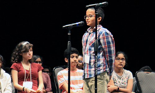 Salyards Middle School sixth-grade student Shawn Ray (at microphone) correctly spelled the word oaxaca in the 24th round of the Middle School Spelling Bee on Feb. 7 to clinch the championship. (CFISD courtesy photo)
