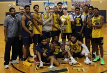 The Cypress Ranch High School boys' basketball team celebrates its District 14-6A co-championship going into the postseason. The Mustangs will be the district's top seed and face Austin Vandegrift at 7 p.m. on Feb. 19 at A&M Consolidated High School. (CFISD courtesy photo)