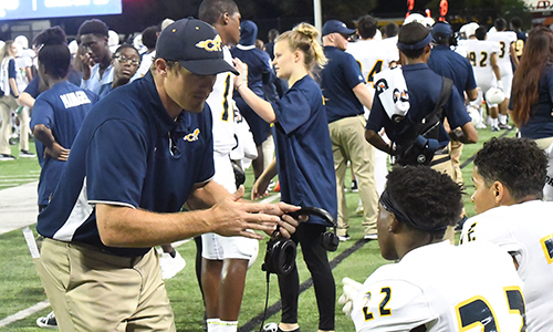 Andrew Shanle (left) has coached and taught at Cypress Ranch High School since 2013, also spending a year with the Mustangs from 2011-2012. The former defensive back played collegiately at the University of Nebraska and won a Super Bowl championship with the New York Giants in 2007. (CFISD courtesy photo)