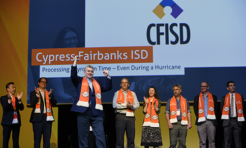 John Crumbley (third from left), CFISD director of information services, celebrates after the announcement that Cypress-Fairbanks ISD received a 2018 Laserfiche Run Smarter Award at the Laserfiche Empower Conference in February. (CFISD courtesy photo)