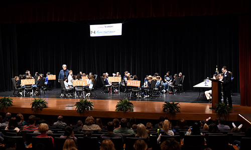 Spectators look on as Roy Garcia (right), CFISD associate superintendent of school administration and leadership development, asks questions to the teams in the finals of the Name That Book contest in February 2018. The 2019 event will take place on March 26 at 5:30 p.m. at the Berry Center. (CFISD courtesy photo)