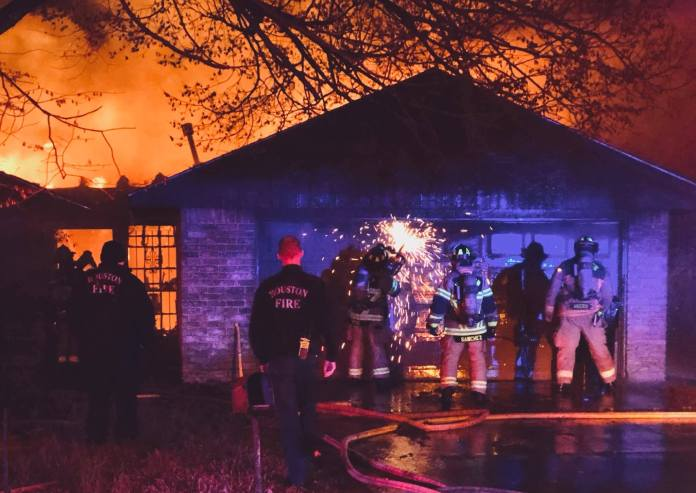 Cy-Fair VFD crews work to extinguish a house fire at 7839 Kellwood Dr., east of Jersey Village. No injuries were reported as of last night. The Harris County Fire Marshal's Office is investigating the cause of the fire. (Courtesy photo by Traci McCabe, EMT-I/ Cy-Fair VFD)