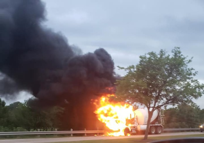 A concrete truck is engulfed by flames this morning on Fry Road. The driver was reported to have safely exited the vehicle. (Cypress News Review - photo courtesy Sara Doyle)