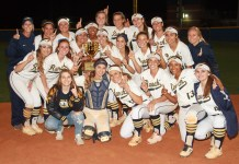 The Cy Ranch softball team celebrates winning the District 14-6A championship. (photo courtesy Greg Andrews)