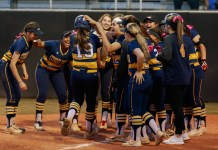 Ashley Croft (#19) is congratulated by her fellow Cy Ranch softball players after her walk-off homerun during their victory over Cy Park during a district game, 11-0, April 2, 2019. (photo courtesy Greg Andrews)