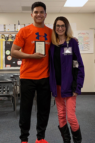 Jersey Village High School senior Joseph Flores (left) qualified to compete at the National Speech and Debate Association National Championship, marking his third trip in three years. He is coached by Jersey Village teacher and debate coach Regina Jennings. (CFISD courtesy photo)