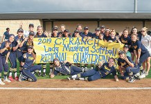 The Cypress Ranch High School softball team celebrates its 2-1 win over Conroe Oak Ridge in extra innings in the Region II-6A quarterfinals on May 10 at Conroe Grand Oaks High School. The win advances the Mustangs to the regional semifinals for the third time since 2015. (Photo courtesy Greg Andrews)