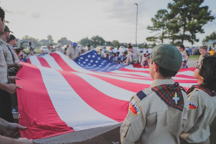 Cub Scout Pack 1445 hosts a Scout Flag Day and Flag Retirement Service in the parking lot of the Langham Creek Ace Hardware in Cypress on Saturday, June 15, 2019. Local Scouts ceremoniously retired three 20-foot unserviceable flags that once flew over the Cypress-Fairbanks ISD Berry Center. (CFVFD courtesy photo by Lt. Daniel Arizpe, PIO)