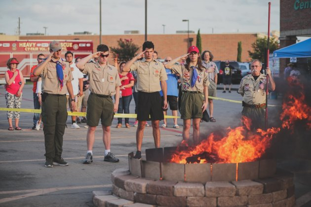 CubScout Pack 1445 hosts a Scout Flag Day and Flag Retirement Ceremony in the parking lot of the Langham Creek Ace Hardware in Cypress on Saturday, June 15, 2019. Local Scouts ceremoniously retired three 20-foot unserviceable flags that once flew over the Cypress-Fairbanks ISD Berry Center. (CFVFD courtesy photo by Lt. Daniel Arizpe, PIO)