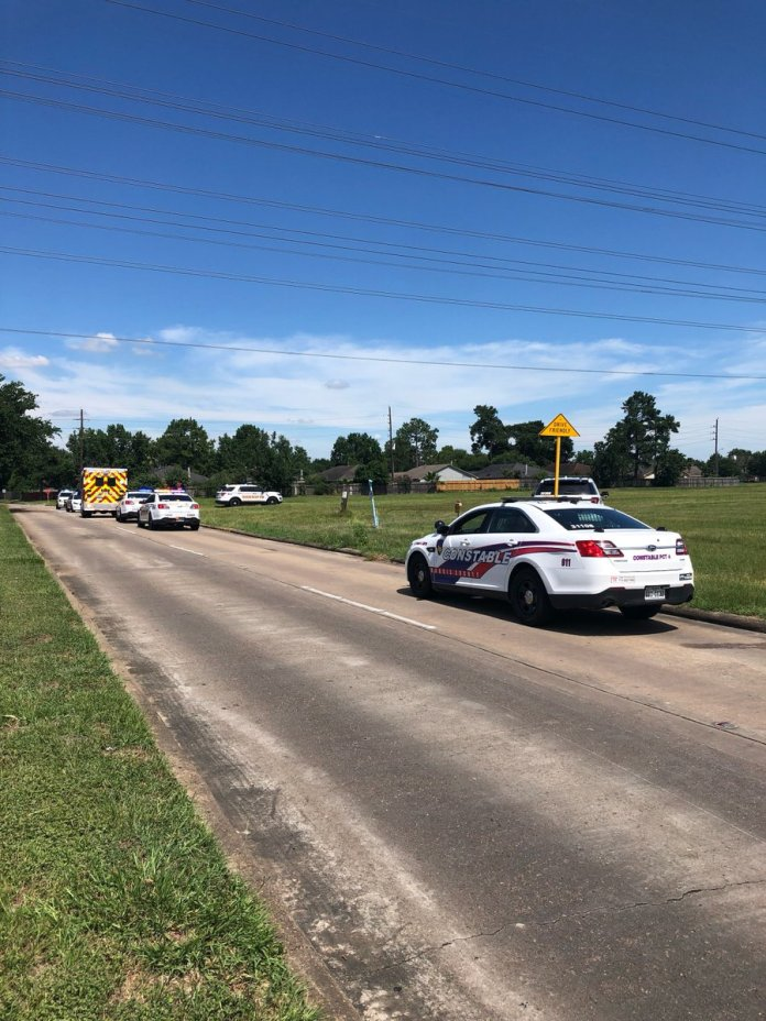 Sheriff deputies and Precinct 4 constable officers search for a pair of golf cart bandits in Cypress yesterday afternoon. (Pct. 4 Constable's Office courtesy photo)