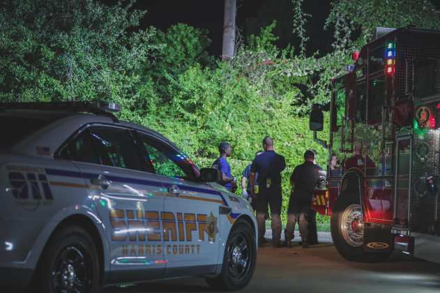 Cy-Fair Fire and EMS crews assist the Harris County Sheriff's Office with a motor vehicle accident involving a single vehicle in the 10200 block of Windfern Road, Aug. 18, 2019. Crews found one patient deceased in a vehicle. The vehicle reportedly left the roadway and ended up in a heavily wooded area along a curve in the road. (CFVFD PIO photo by Lt. Daniel Arizpe)