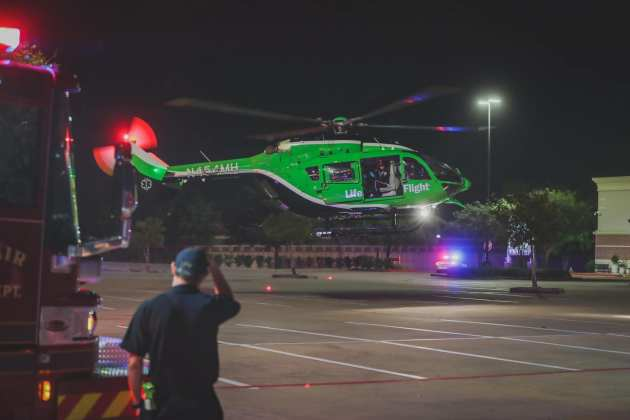 Cy-Fair Volunteer Fire Deparment EMS crews and Memorial Hermann Life Flight assist Harris County Constable Precinct 4 with a motor vehicle accident at the intersection of the Northwest Freeway and Hempstead Road in Cypress Sunday night. One of the Life Flight helicopters in their fleet is green to highlight Children's Memorial Hermann Hospital. (CFVFD PIO photo by Lt. Daniel Arizpe)