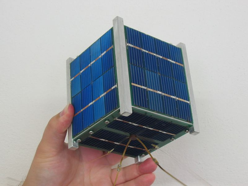 cubesat held in a hand