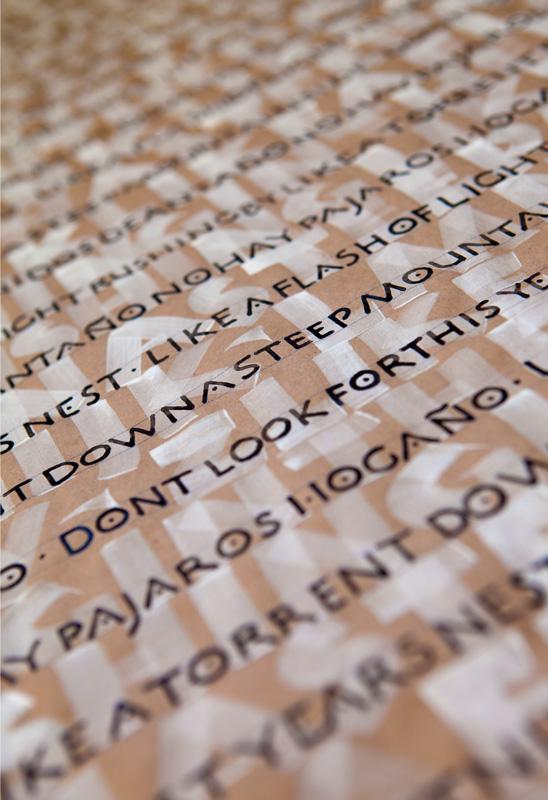 Combination of brush written Neuland and pen written Roman capitals