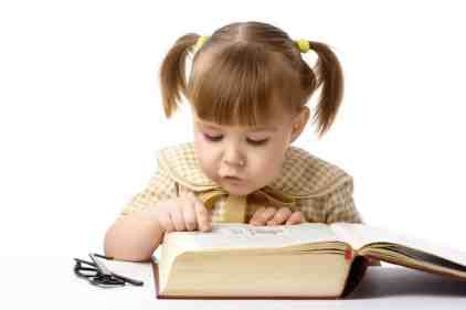 Cute cheerful child with book, isolated over white