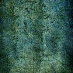 Abstract color photograph featuring black, white, gray, green, blue and cyan.