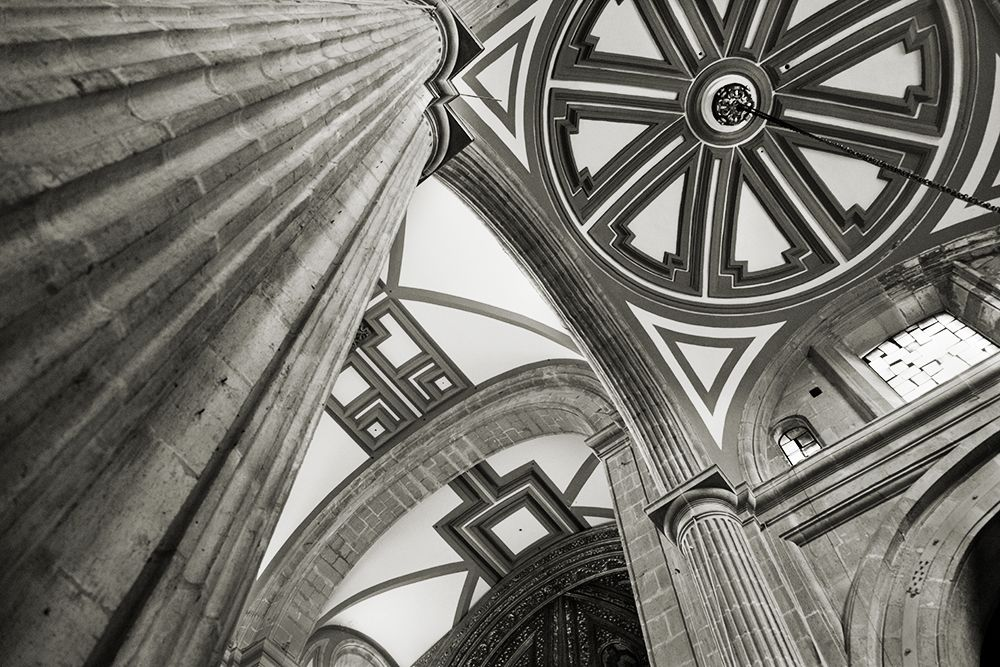 Black and white photo of the ornate ceiling of a gothic cathedral.