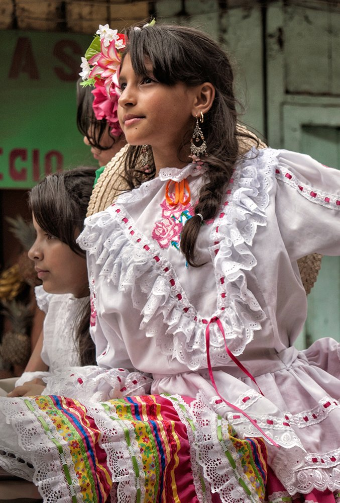 Color photo of a girl wearing a traditional Colombian dress.
