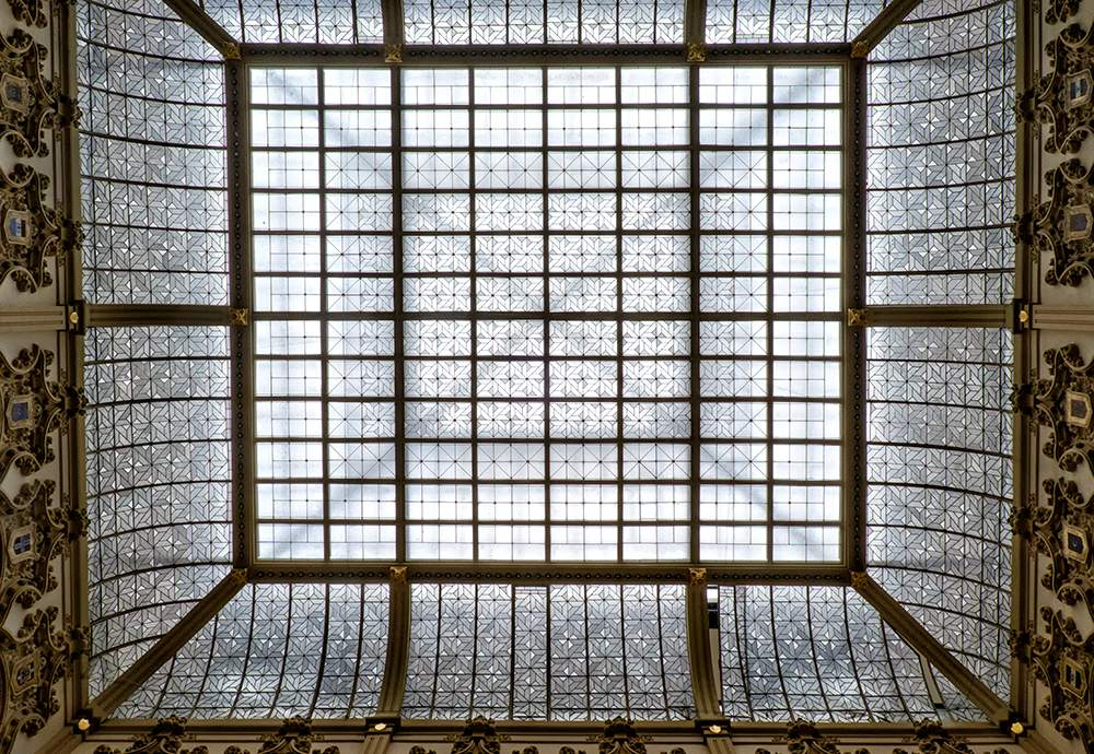 Color photograph of an ornate antique skylight.