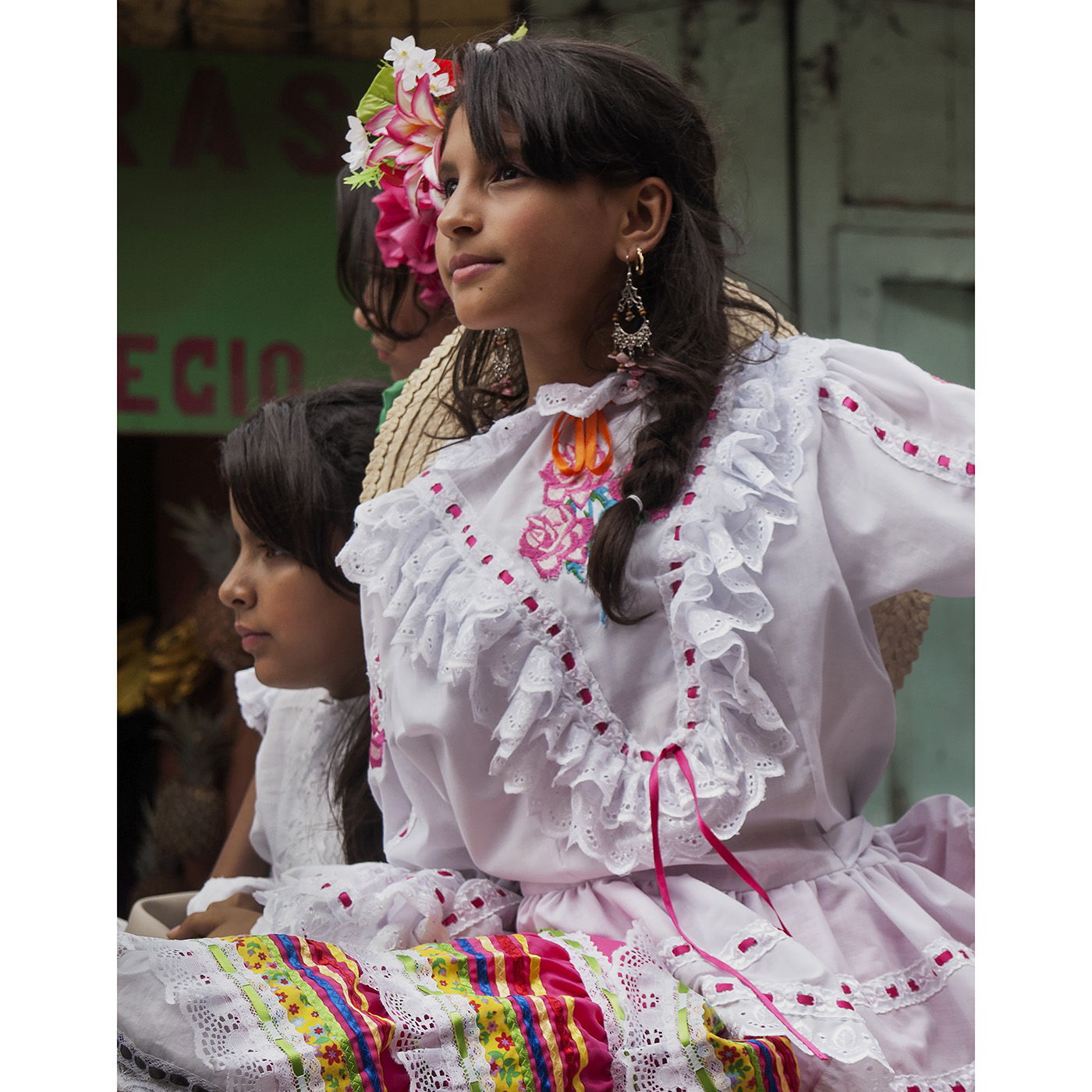 A girl wears a traditional festival dress during a parade in Libano, Colombia.