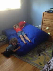 The Monster and R playing with the crash pad in Monster's room