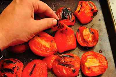 Peeling the skins from the tomatoes