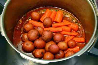 Potatoes and carrots in steamer basket