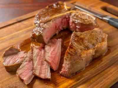 Porterhouse steak with slices on a cutting board