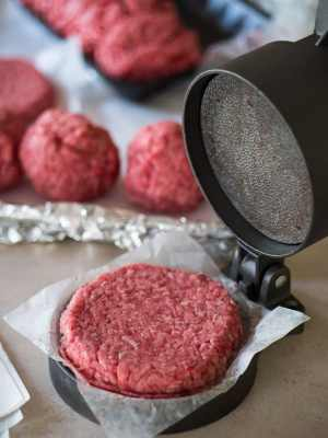 Using a hamburger press to make the burger patties - Jalapeno Cheeseburgers With Grilled Onions   DadCooksDinner.com