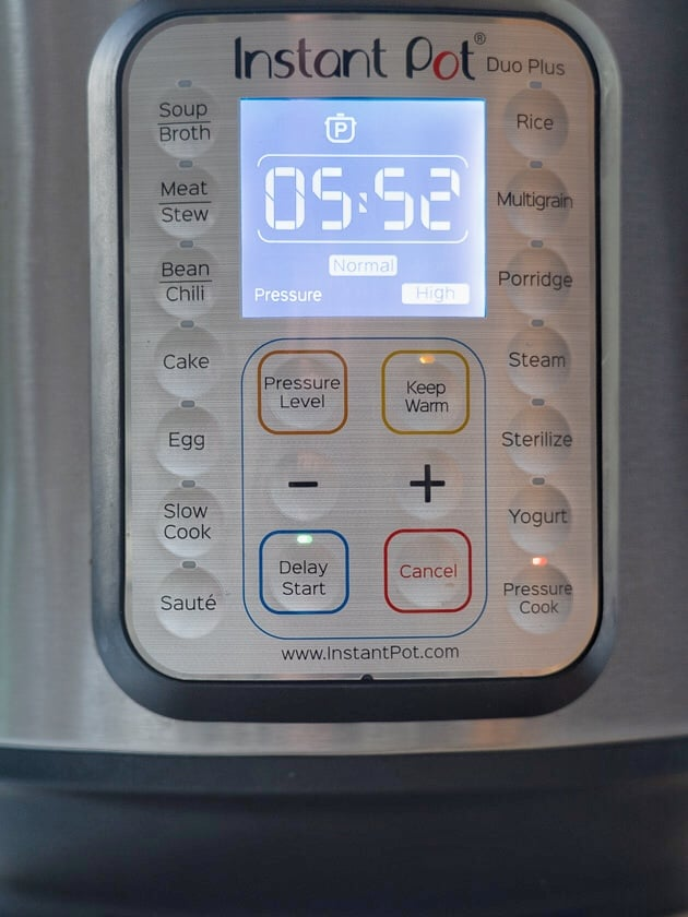Instant pot control panel with Delay Start button lit up