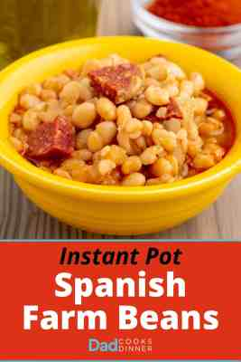 A yellow bowl of alubia blanca beans with chorizo and a red sauce, with olive oil and smoked Spanish paprika in the background, with the text Instant Pot Spanish Farm Beans underneath.