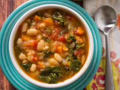 A bowl of Tuscan bean soup on a colorful plate
