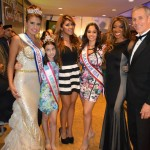 (Lt to Rt) Pageant Winners with Mistress of Ceremonies Gia Acevedo, host Mayra Joli Esq, & Master of Ceremonies Steven Befera Esq