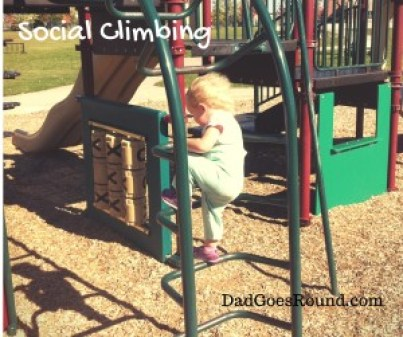Image of a toddler climbing rungs of a playground ladder